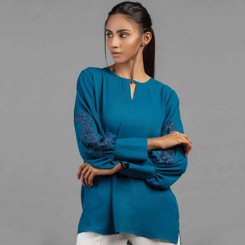 A vivid blue top embellished with embroidery and flowy sleeves.